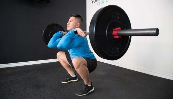 Man Performing Squats-min